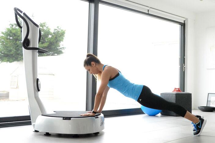 Push up on gym vibration plate