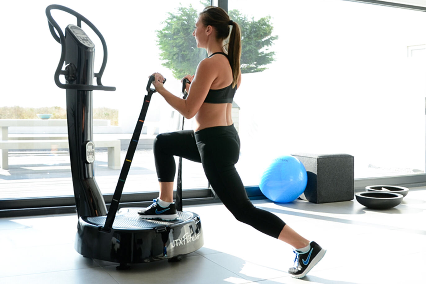 Tri plane vibration plate compact work area